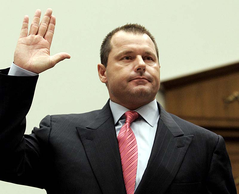Former New York Yankees pitcher Roger Clemens is sworn in on Feb. 13, 2008, prior to testifying before a House committee hearing on drug use in baseball. HGH oath performance-enhancing drugs professional baseball playe