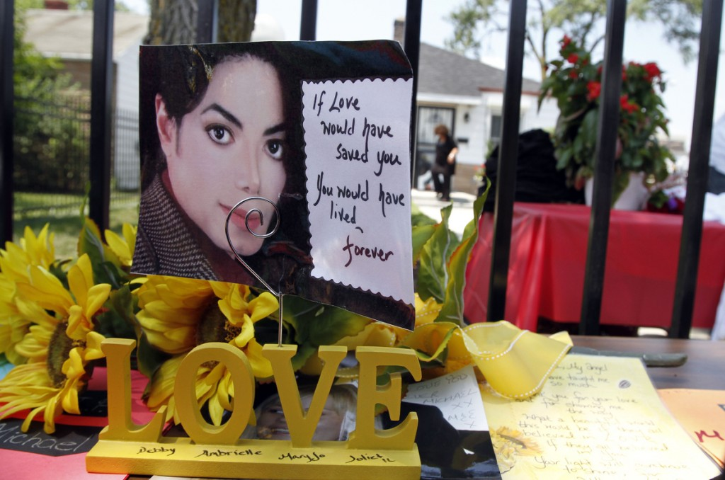 Cards and flowers adorn Michael Jackson's boyhood home in Gary, Ind. A multimillion-dollar lawsuit against the late singer over a failed reunion concert was dismissed Thursday.