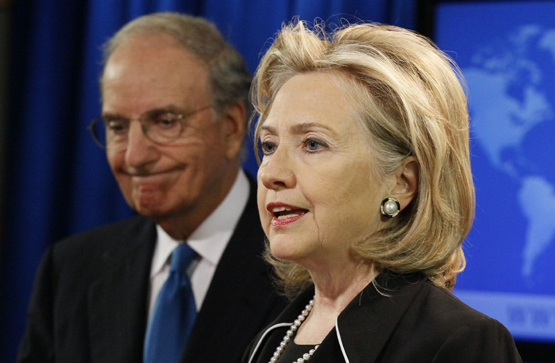 Secretary of State Hillary Rodham Clinton, right, accompanied by special Mideast peace envoy George Mitchell, talks with the media about Mideast peace talks today.