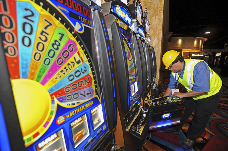 Lincoln Schwitters, a technician with Bally Technology, a maker of slot machines, sets up machines in Perryville, Md., this month. Hollywood Casino in Perryville is expected to open on Sept. 30 as Maryland's first slot casino, joining dozens of others along the Eastern Seaboard. Maine voters will consider in November whether to approve a gambling facility in Oxford County.