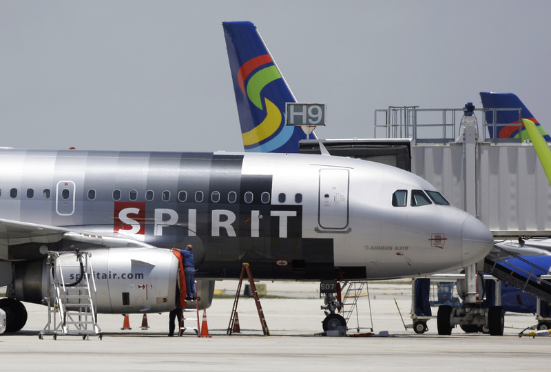 A Spirit Airlines airplane sits on the tarmac at Fort Lauderdale-Hollywood International Airport in Fort Lauderdale, Fla., in this file photo. A new fee on carry-on bags took effect on Sunday.