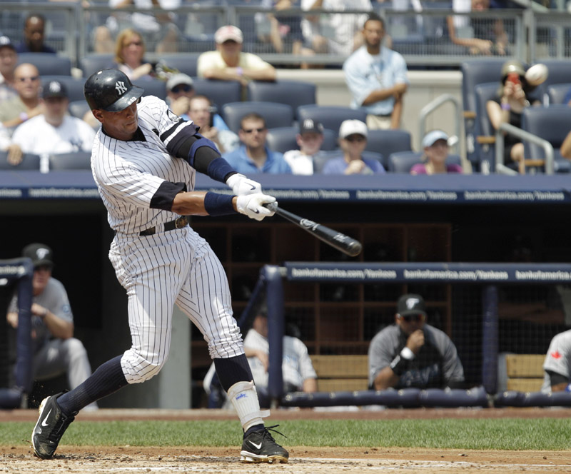 New York Yankees' Alex Rodriguez connects for his 600th career home run during the first inning of a game against the Toronto Blue Jays at Yankee Stadium today.