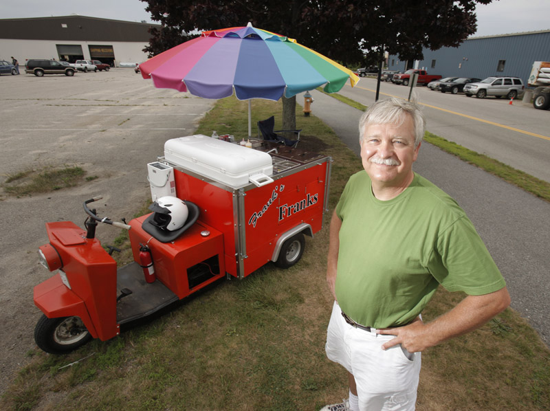 Frank Marston runs his hot dog cart, Frank's Franks, near Bug Light Park in South Portland. Marston started selling hot dogs this year in the cart that he adapted from a Cushman truckster. Marston says the design of the cart centered around the biggest cooler he could find.