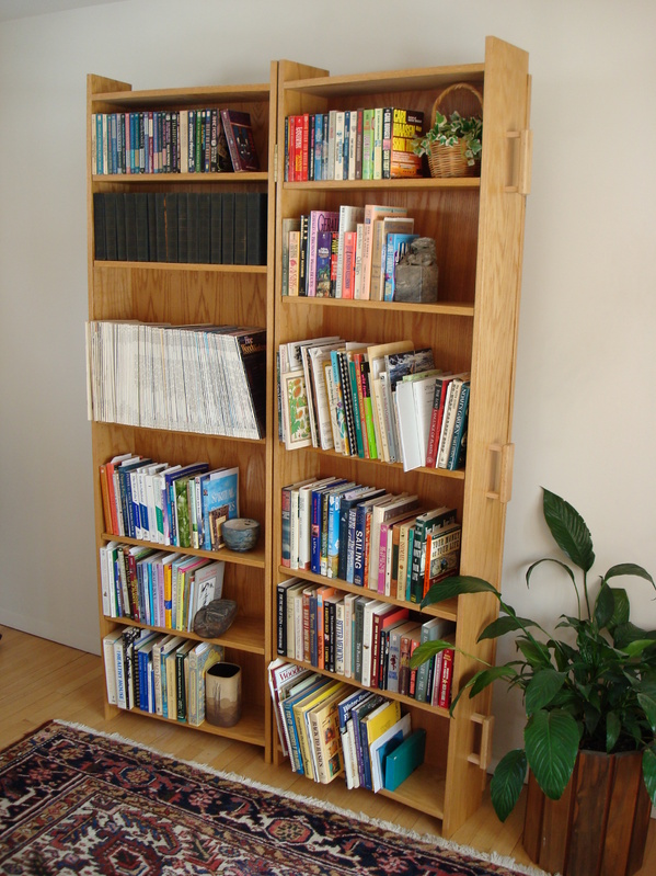 The bookcase coffin, basically two boxes hinged together, has adjustable shelves.