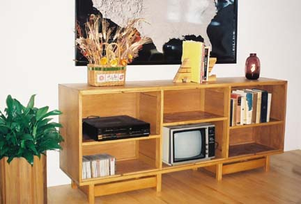 The multi-purpose coffin is used here as an entertainment center.