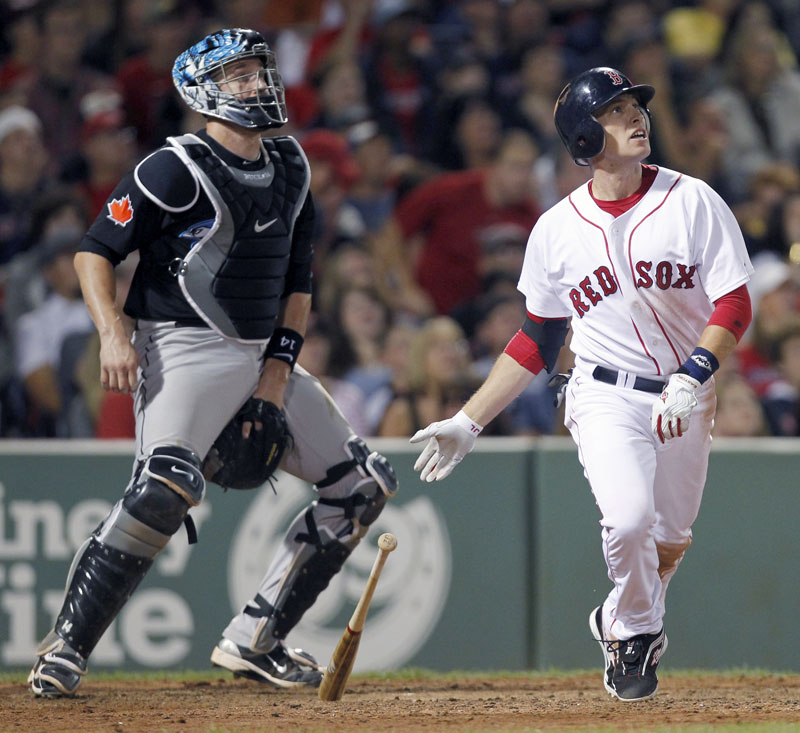 Jed Lowrie homered in the bottom of the 11th inning Saturday night as the Red Sox beat the Toronto Blue Jays 5-4 in Boston.