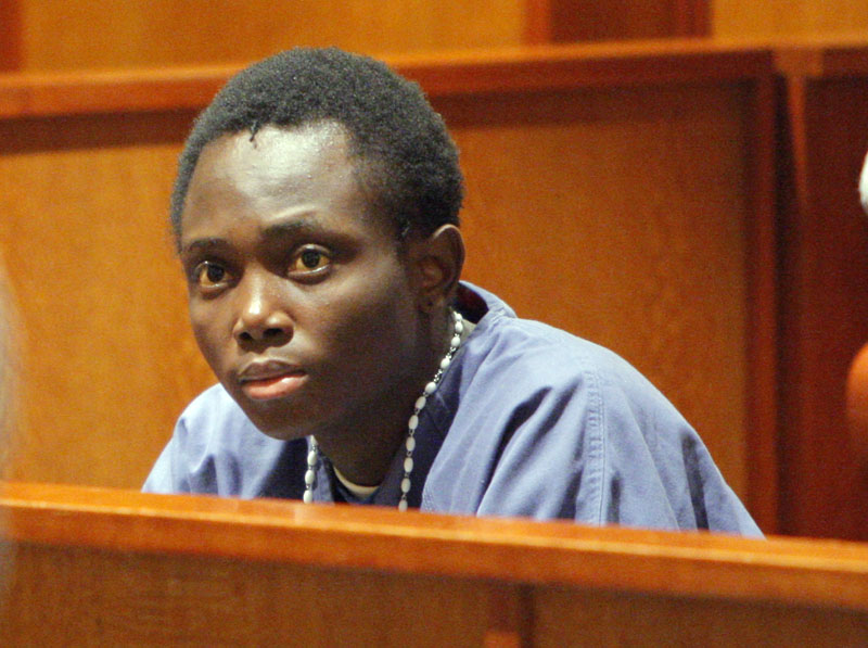 Before his sentencing, Yannick Mulongo, 22, listens as the brother of Guy Kitoko addresses the court.