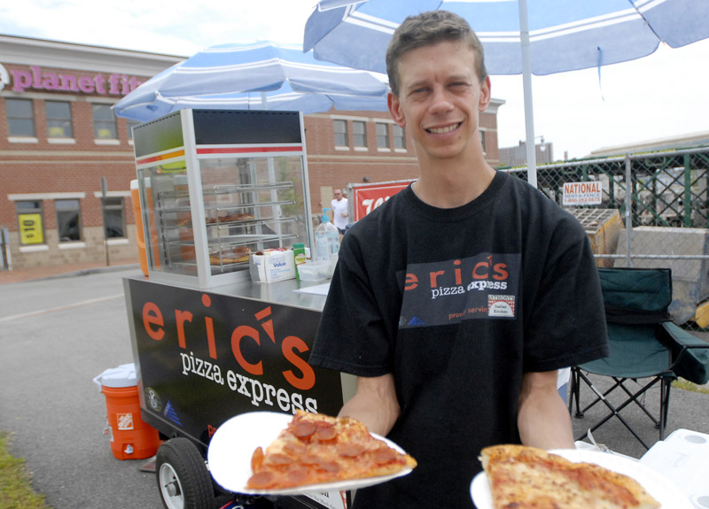 "Fulfilling a lifelong dream to operate a food cart all his own, Eric Hughes has opened a pizza business operating at the corner of Marginal Way and Chestnut Street in Portland. Eric, who has a rare disease that impedes certain brain functions, has impressed supporters with his eagerness to learn and ever-present smile. ""Once you talk with him, you realize it's a serious endeavor and not just a whim,"" said Peter Brown, who oversees Strive U, a program that helps young adults with developmental disabilities learn to live independently."