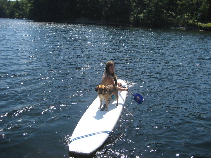 Abigail Matlack and Pancho Villa of Camden, the defending champion in the Boatyard Dog Trials, practice surfboard skills for the Aug. 15 contest.