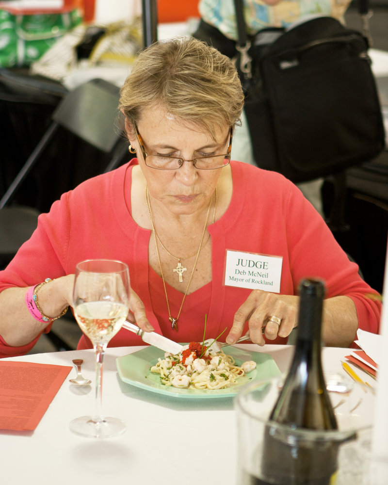 Rockland Mayor Deb McNeil samples a dish at last year's Seafood Cooking Contest. McNeil will be on the judges' panel again this year.