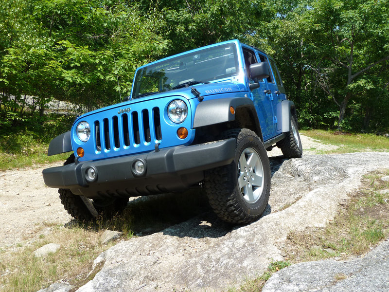 Although the four-door Jeep Wrangler Unlimited is much more practical than its two-door counterparts, nobody is going to confuse it with a grand-touring sedan. But you wouldn't dare take a conventional sedan to the remote, off-road locations the Wrangler is quite capable of going.