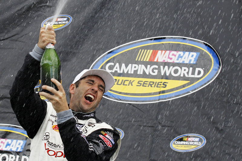 Elliott Sadler celebrates after winning the Camping World Truck Series race Saturday at Pocono Raceway – his first victory at any NASCAR level since 2004.