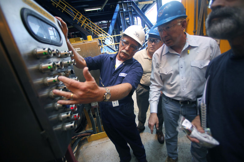Interior Secretary Ken Salazar, second from right, looks at blowout preventer controls as he tours the Murphy Front Runner deep-water oil drilling rig in the Gulf of Mexico on Wednesday. Second from left is Deputy Interior Secretary David Hayes, and partially visible at right is the director of the Bureau of Ocean Energy Management, Regulation and Enforcement, Michael R. Bromwich.