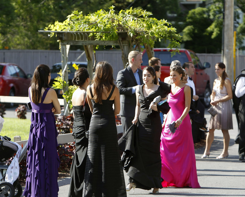Guests wait for a bus to depart the Delamater Inn to go to Chelsea Clinton and Marc Mezvinsky's wedding at the riverside estate of Astor Courts in Rhinebeck, N.Y., on Saturday.