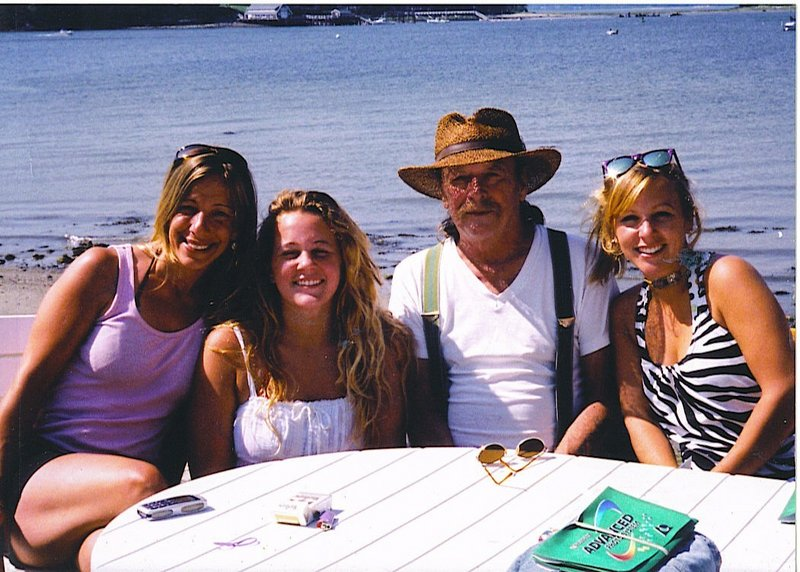Chris Tuttle and his three daughters, from left, Amy Pelletier, Maggie Tuttle and Celia Tuttle, hang out at the beach.