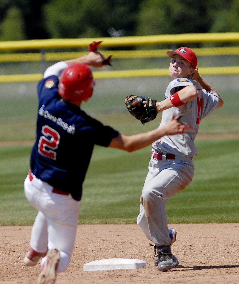 Luke Cote of Gayton Post throws to first base to complete a double play after forcing Augusta's Colin McKee at second.