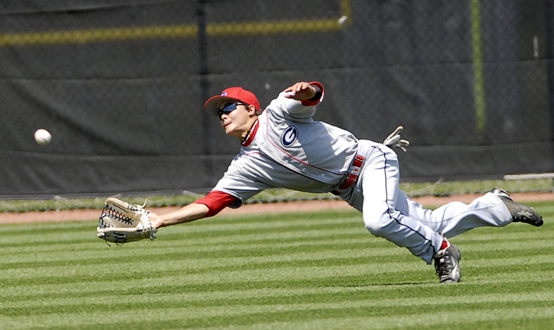 Gayton center fielder Alex Wong, the tournament MVP, dives for a fly ball but can't make the catch Sunday against Augusta in the American Legion baseball state tournament at South Portland.