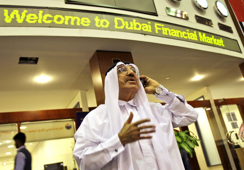 A man using a smartphone at the Dubai Financial Market in Dubai, United Arab Emirates, is a common sight that may change. The UAE said Sunday it will block key features on BlackBerrys because the government can't monitor their use.