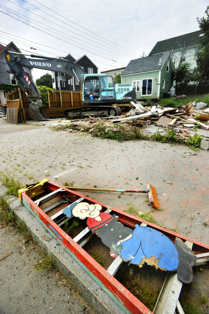 A plywood cutout of the cartoon character is all that remains of the former Popeye's Ice House bar in Portland on Tuesday. The owners had closed the tavern in 2008.