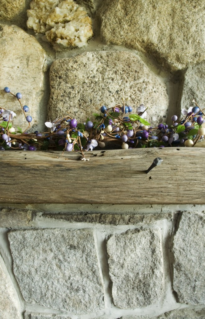 The wood for the mantel of the home's fieldstone fireplace came from a shipwreck.