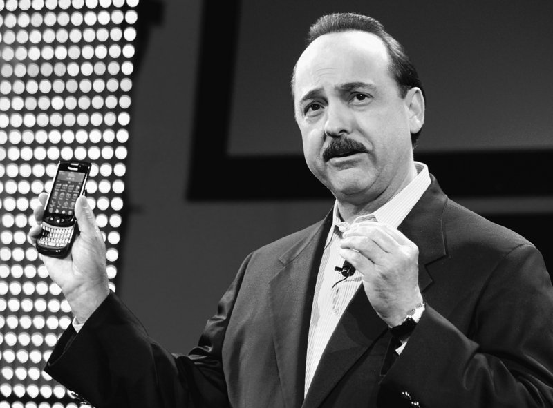 Ralph de la Vega, president of AT&T Mobility and Consumer Markets, holds the new BlackBerry Torch on Tuesday in New York. It is the first BlackBerry with a touch screen and full-alphabet keypad.