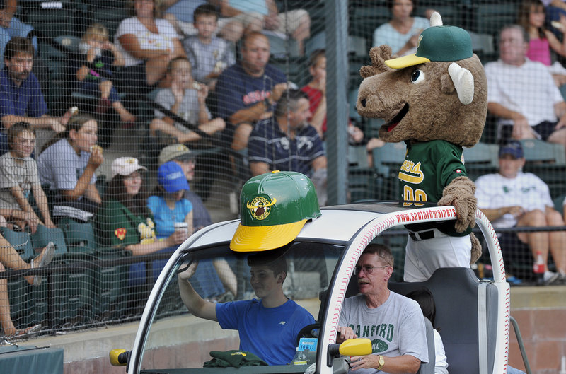 Broose the Moose, mascot of the Sanford Mainers, entertains fans between innings of an NECBL playoff game. The Mainers beat the North Shore Navigators to force a deciding game tonight.