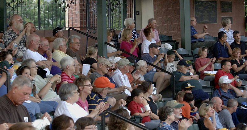 Fans of the Sanford Mainers and North Shore Navigators cheer their teams Tuesday night during a playoff game at Sanford's Goodall Park.