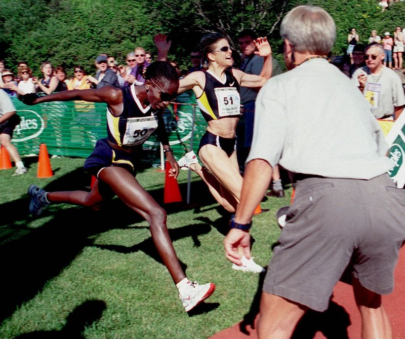 Catherine Ndereba surges for the victory in 2000 as Libbie Hickman holds up her hands, thinking the ceremonial finish line was the real finish.