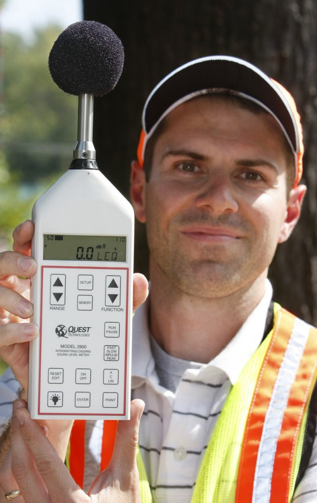 Howard shows the sound-level meter he used Wednesday to take readings near the sound barrier.