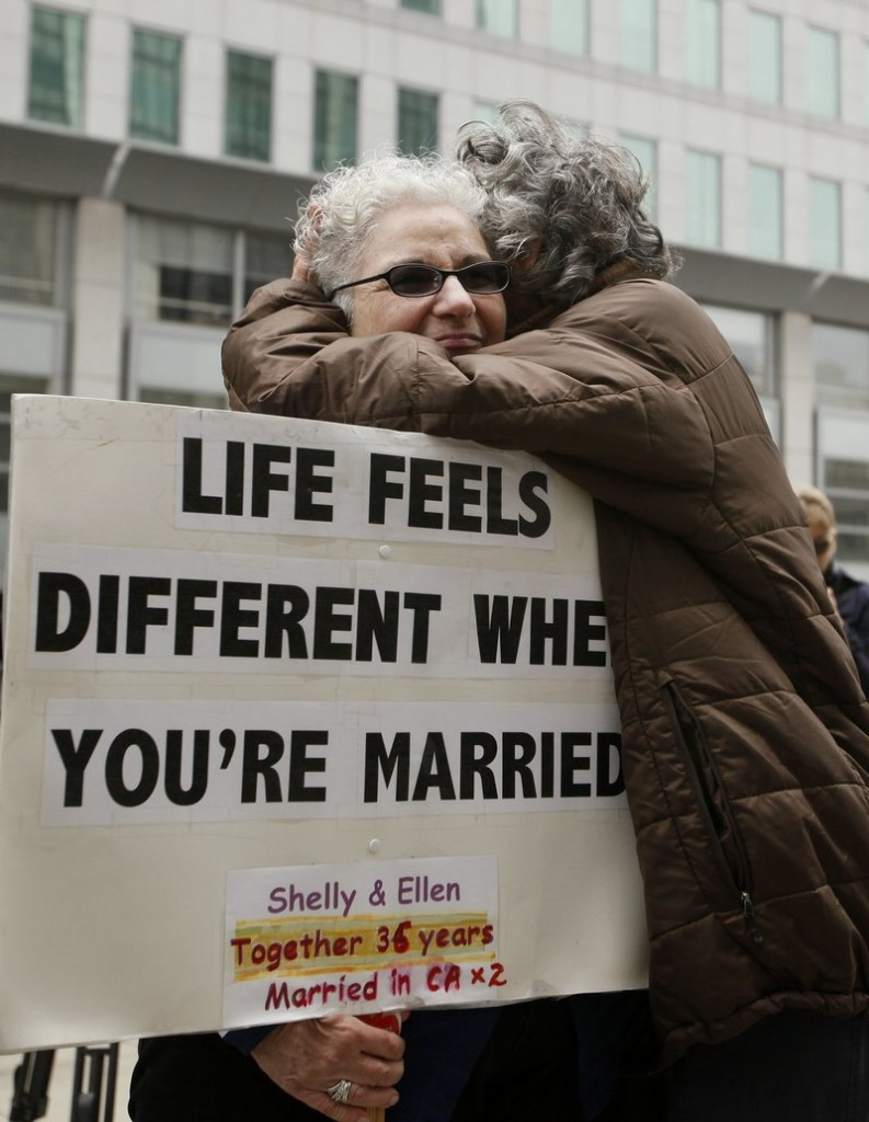 Shelly Bailes, left, hugs her wife, Ellen Pontac, outside the Phillip Burton Federal Building in San Francisco on Wednesday.