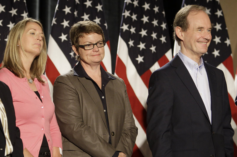 Sandy Stier, left, and Kris Perry attend a news conference with attorney David Boies in San Francisco on Wednesday. Stier and Perry were plaintiffs in a federal court case challenging Proposition 8, California's ban on same-sex marriages.