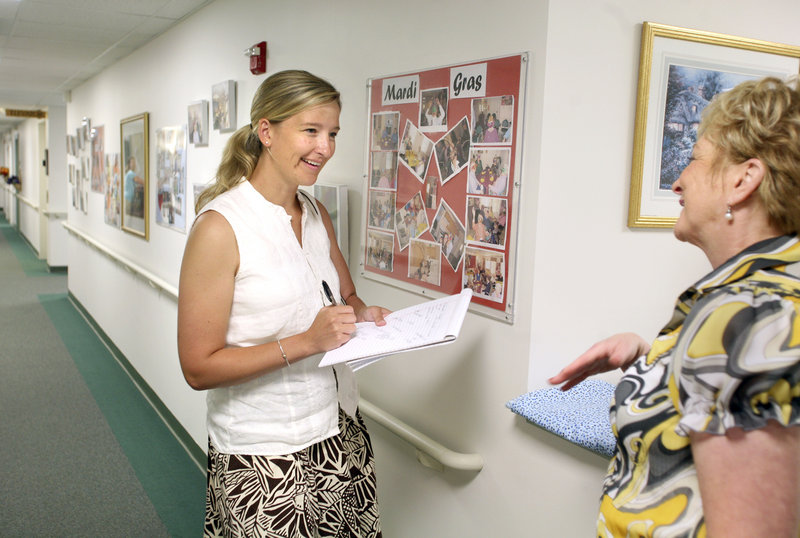Lynn Peel, a senior care consultant, left, takes notes while touring OceanView at Falmouth with Maureen Connolly, director of operations and marketing.