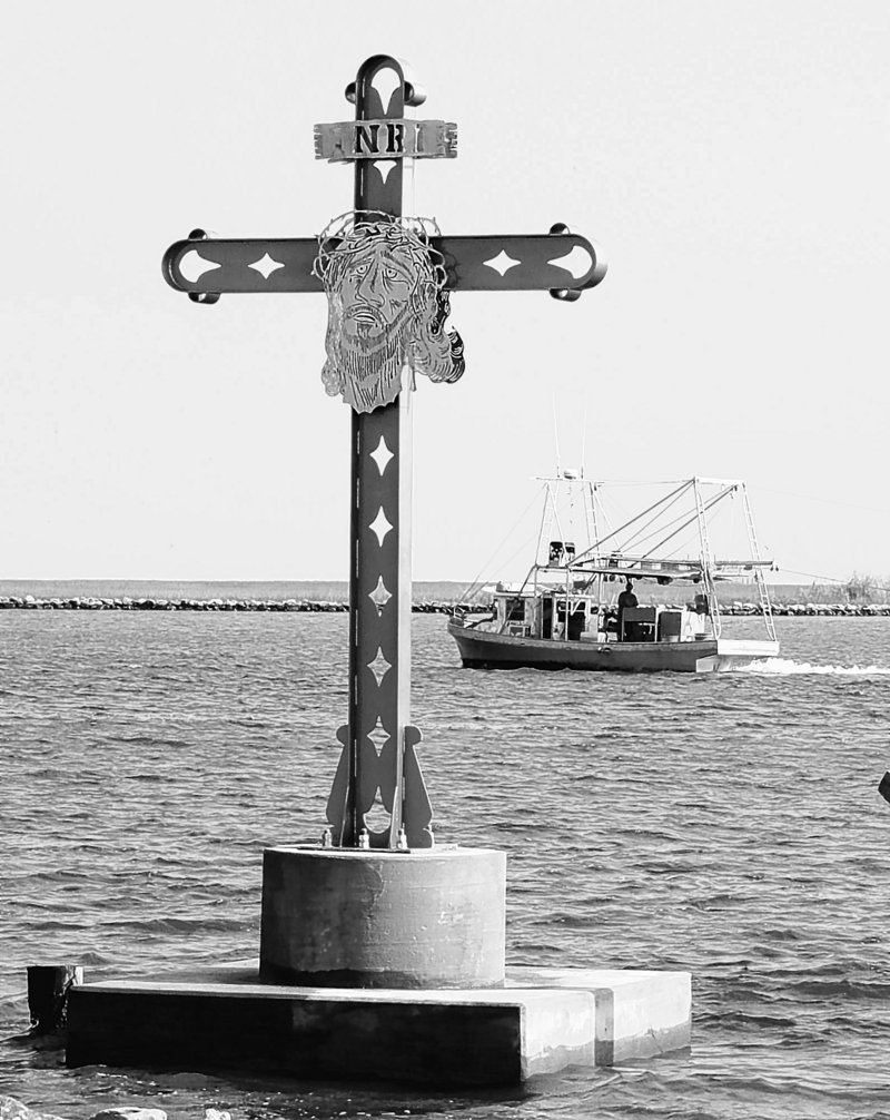 In this Aug. 29, 2006 file photo, a shrimp boat works its way up the Mississippi River Gulf Outlet, past a monument to the people who lost their lives in St. Bernard Parish in Shell Beach, La.