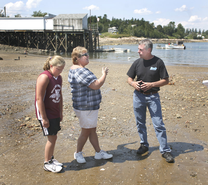 Shawn Moody, running as an independent, stops on his statewide travels to talk with Annie Perry and her daughter Maggie of Gouldsboro Point in Prospect Harbor on Friday.
