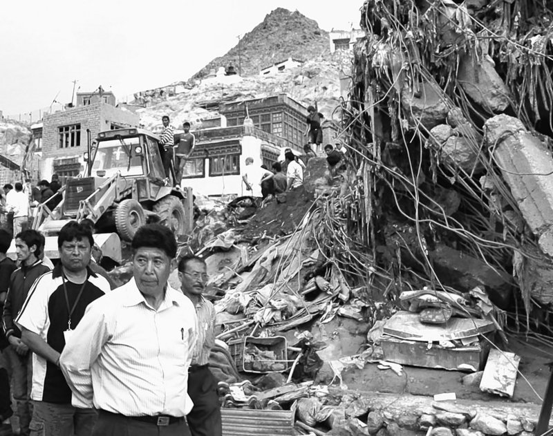 Officials inspect the damage in Leh, in Indian-controlled Kashmir's mountainous Ladakh region, after Friday's flooding.