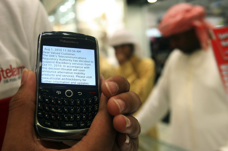 A BlackBerry user in Dubai, United Arab Emirates, displays a text message sent by his service provider on Thursday, notifying him of the suspension of BlackBerry messaging services,
