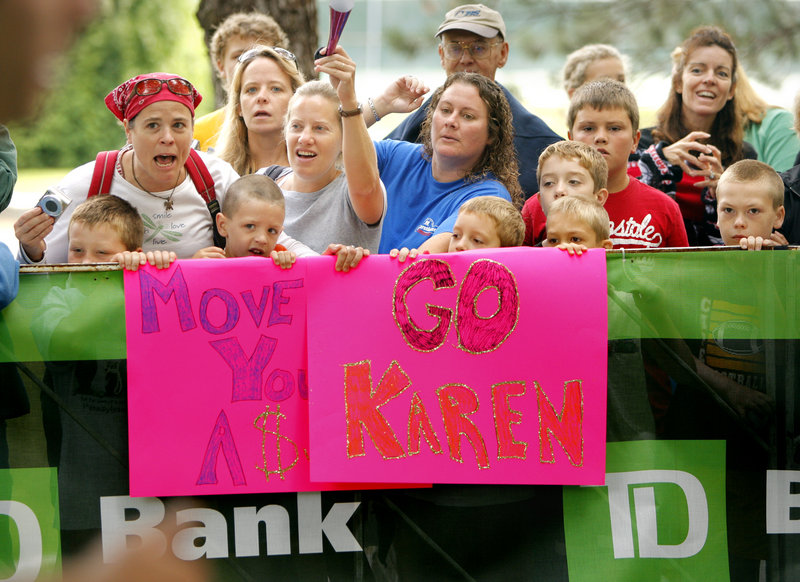 Spectators offer encouragement as runners climb the hill at the entrance to Fort Williams Park, with the finish line awaiting less than half a mile ahead.