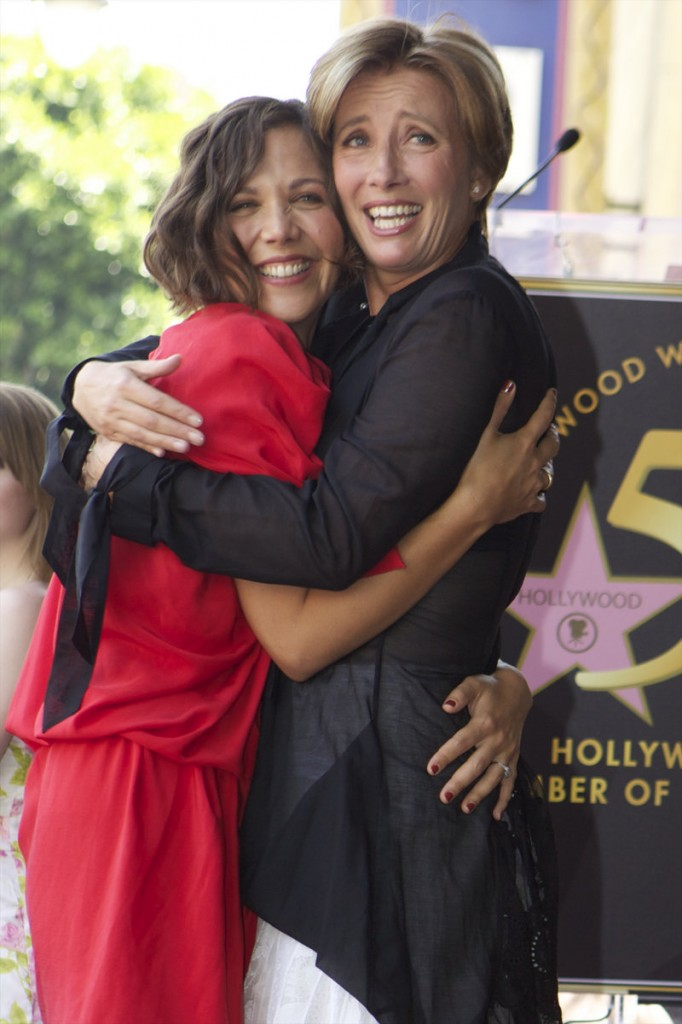 British actress Emma Thompson, right, hugs friend Maggie Gyllenhaal, as she is honored with a star on the Hollywood Walk of Fame in front of the Pig 'n Whistle pub in Los Angeles on Friday.