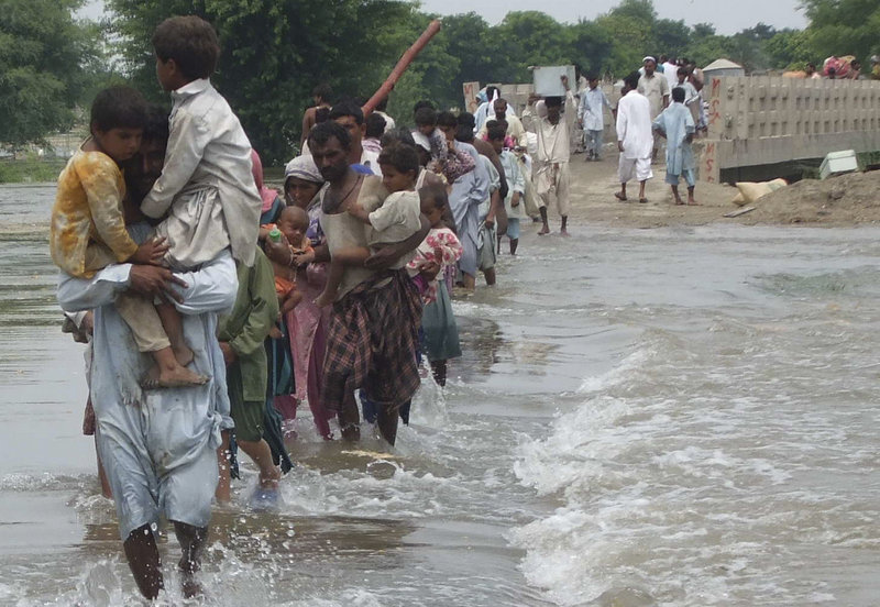 Pakistanis flee their flooded villages in Rajanpur on Sunday. The south Asian country will need billions of dollars to recover from its worst floods in history, further straining a country already dependent on foreign aid to prop up its economy and back its war against Islamist militants, the U.N. said.
