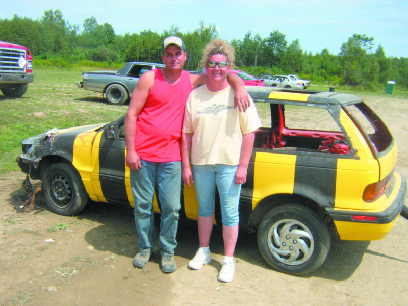 """Shane and Sonya Williamson, operators of Boondocks Raceway in Skowhegan, take a break from the shooting of """"Bumble Bee Cabs"""" on Sunday. Parts of the short film, directed by former Skowhegan resident Mo Twine, were shot here."""