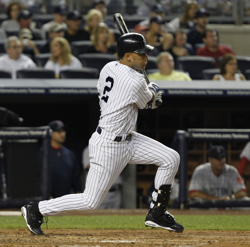 Yankees captain Derek Jeter follows through on his 2,874th career hit, an RBI single in the second inning that pushed him ahead of Babe Ruth into 38th place on baseball's all-time list.