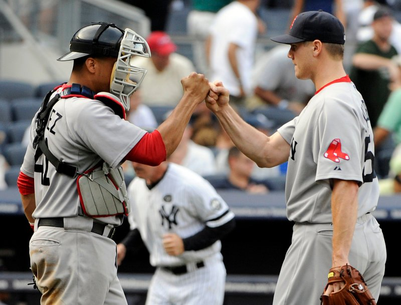 The Associated Press Jonathan Papelbon, right, celebrates with Victor Martinez after the Red Sox beat the Yankees 2-1 Monday in New York. Papelbon pitched 1 1⁄3 scoreless innings for his 28th save.
