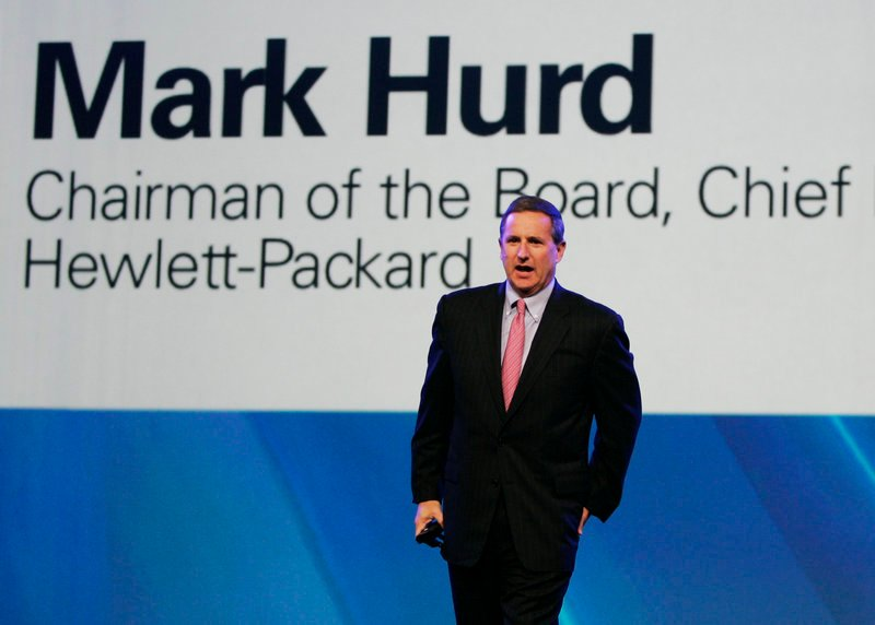 Mark Hurd, then Hewlett-Packard's CEO, walks on stage during the 2007 Oracle Open World conference in San Francisco. His severance for a forced resignation could top $40 million.