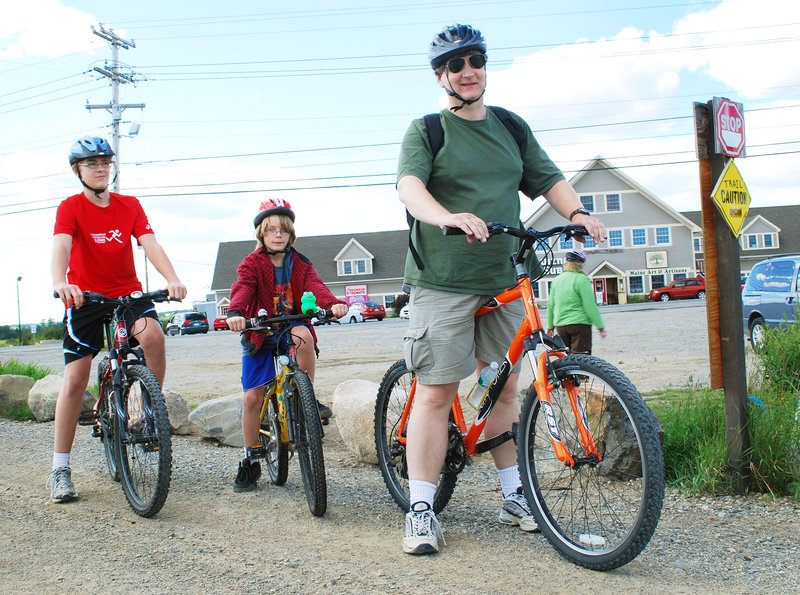 Alex Diehl and his sons Markus, left, and Fridrik prepare to bike the Down East Sunrise Trail from Machias. They are excited the trail will be extended to near Ellsworth this fall.