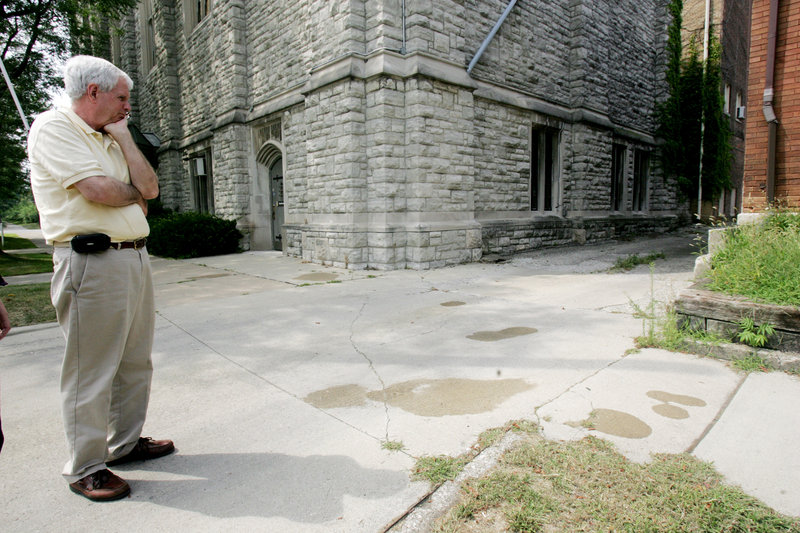Collingwood Presbyterian Church pastor Robert Anderson stands near the spot in Toledo, Ohio, where church custodian Tony Leno was stabbed Saturday night while giving directions to a motorist.