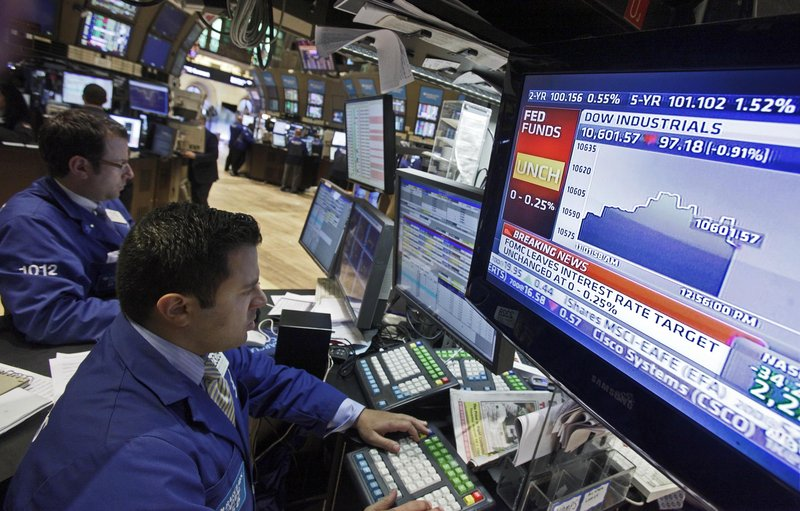 A monitor on the floor of the New York Stock Exchange shows the Fed Funds Rate and stock market data after the Federal Reserve's decision Tuesday to buy government debt.