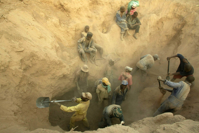 Miners dig for diamonds in Marange, Zimbabwe, in 2006, in a mine that became notorious for human rights abuses.