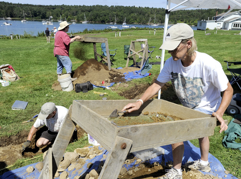 Kaare Mathiasson, from left, Cindy Hook and Carolyn McKeon work a dig site Wednesday at the Pemaquid State Historic site in New Harbor. Archaeologists are searching for the remains of a 17th century British fishing village thought to be buried at the site.