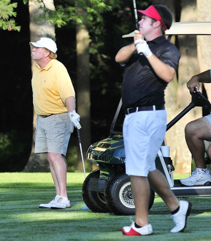 Ryan Gay, right, and Mark Plummer follow Gay's fairway shot Wednesday during their match at an MSGA tournament. Plummer won 1-up in 21 holes to advance to the quarterfinals.