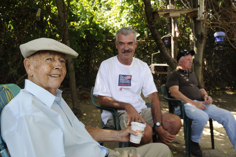 Yearning for a place to hang out and socialize, Jim Ridley, center, decided to carve out a meeting spot in a tangle of scrub trees at Bug Light Park in South Portland. Now he's joined regularly by about 20 men, including fellow Willard Square residents Burton Bridges, left, and Russell Yeaton. They have gathered for the past several years to chat and watch the animals, which include hundreds of birds, squirrels, foxes, skunks and some groundhogs.